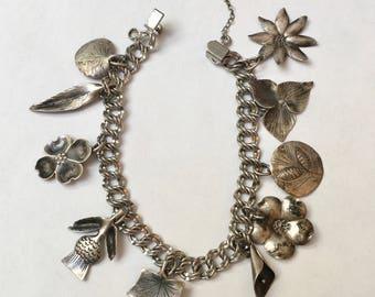 vintage sterling Stuart Nye charm bracelet with flowers and leaves
