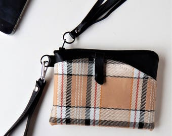Leather wristlet in plaid with outside pocket.
