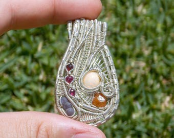 Welo Opal, Spessartite, Grape Chalcedony and Ruby Sterling Silver Heady Wire Wrap Pendant