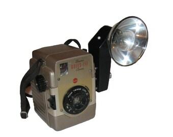 Vintage KODAK Brownie Bullseye Camera with flash attachment and strap, box camera
