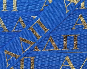 58 royal blue with gold alpha delta pi letters fold over elastic