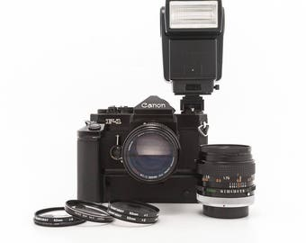 Canon F-1 35mm film camera with Canon FD 50mm f1.4 Prime lens, 85mm f1.8 Lens, Canon Speedlite 199A, Macro Kit