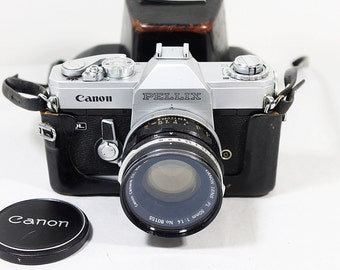 Vintage Canon Pellix QL Roll Film Camera with 50mm F1.4 Lens and Original Black Leather Case