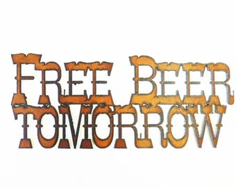 Free Beer Tomorrow sign made out of rusted rustic rusty metal
