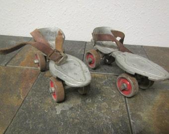 pair of old metal HUSTLER Speed King ROLLER SKATES ** Hustler corp. Sterling Illinois