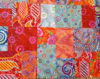 Unfinished Quilt TOP in all Kaffe Fassett fabrics in red, orange, and blue bright colors. 45.5 x 56.5 inches