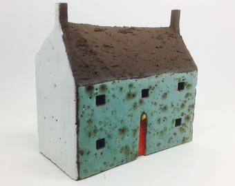 Ceramic Cottage with Turquoise Speckled Wall
