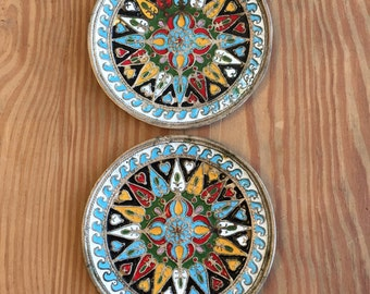 Pair of enameled pewter plates