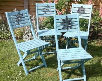 Four Seagreen/blue colour,wooden garden chairs