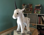 Magical stuffed toy unicorn handmade from high quality white cotton fleece featuring a silvery gray horn