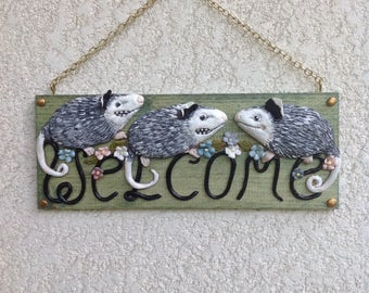 Opossum welcome sign