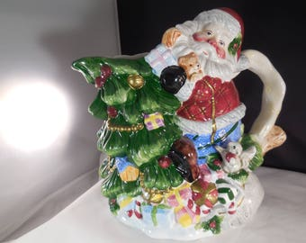 Santa Clause Christmas pitcher with a bag of toys, a Christmas tree, packages  produced by WCL.
