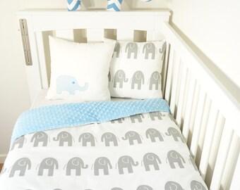 Grey and baby blue elephant nursery set items