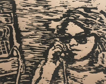 Woodblock print of girl on payphone