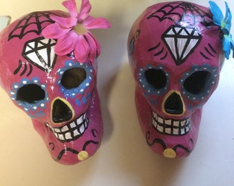 Hand-painted mauve sugar skull with pink or blue flower
