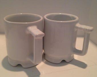 Two white glazed Frankoma coffee mugs