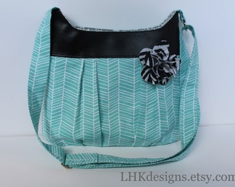 Aqua teal crossbody bag purse with vinyl accents and removable fabric flower embellishment