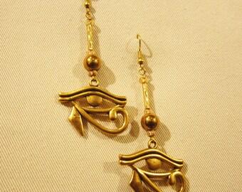 """Egyptian Eye of Horus gold tone earrings. 3"""" or 7cm long x 1.25"""" or 3cm"""