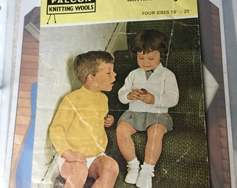 Falcon knitting pattern , childrens v and round neck cardigan 1950's