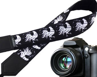 White rooster camera strap. Chicken. Symbol 2017.  Stylized cocks. Padded camera strap. Black and white. Camera accessory.