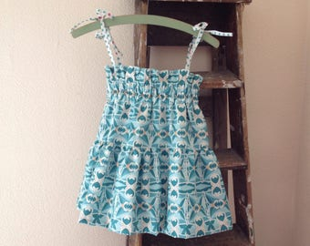 Ruffle top Age 6 - 8 // twirling colorful pattern // turquoise cotton with tie straps strappy //