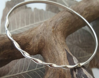Sterling silver bangle with a tight twist