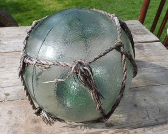 Authentic Extra Large Vintage Glass Fishing Float With Rope Netting Dark Green Chunky Glass Original Used Condition Garden or Home Decor #1