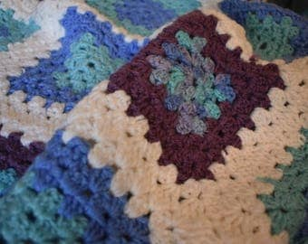 Cuddle Bug Crochet Baby Blanket with Granny Squares of Blues, Teals, Purple, & White