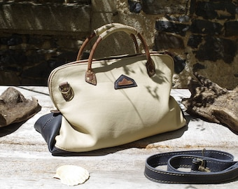 Large handbag, beige and black leather travel bag