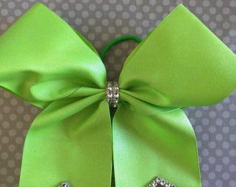 Green glitter grosgrain cheer bow on a pony O