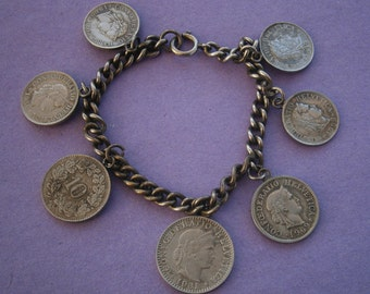 B950) A lovely vintage silver tone metal Swiss Switzerland coins from 1931 to 1970 souvenir coin bracelet