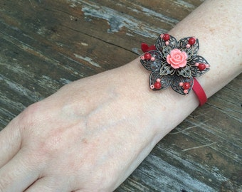 Victorian style corsage bracelet in coral and red tones
