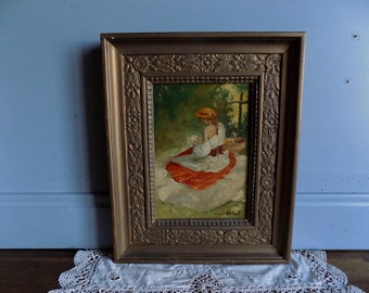 Beautiful French vintage oil painting on wood of a lady, signed Palet with ornate frame.