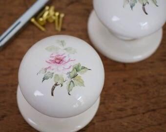 Pair of vintage salvaged floral ceramic door knobs