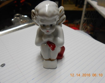 White Sitting Cherub ~ Red and Gold Accents
