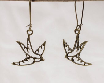 Earrings with bird in bronze