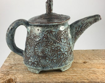 Teapot oval hand built pottery with texture on surface