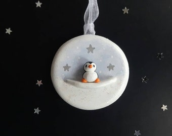 Miniature pottery penguin decoration. Little penguin Christmas ornament, mini silver stars and glitter