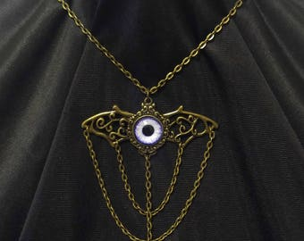 Gold winged pendant with purple eyeball chain and crystal teardrop bead detail steampunk necklace with matching earrings handmade jewelry
