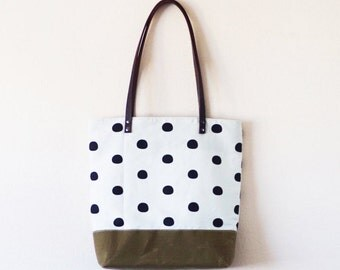 Waxed olive canvas tote bag with off round polka dot print and brown leather handle