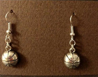 Silver basketball with silver fishhooks
