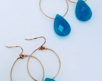 Gold hoop earrings with faceted tear drop cotton candy quartz accents