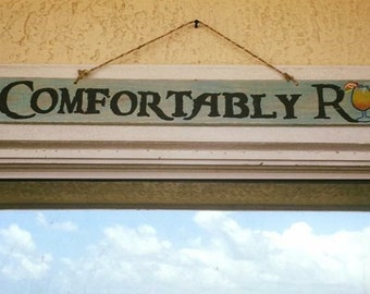 Comfortably Rum Sign
