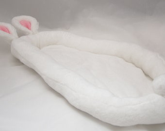 Fluffy soft bed for a bunny or another animals