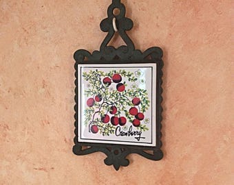 Vintage cast iron and ceramic tile trivet, cranberry pattern trivet.