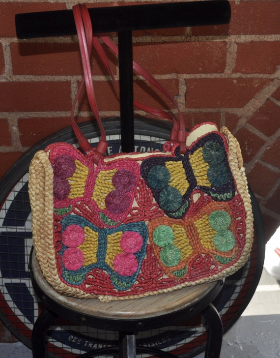 Bright Woven Straw Bag Purse with Butterfly Motif and Red Leather Handles and Snap Closure