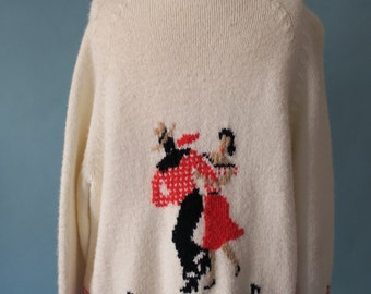 Vintage white hand knitted cowichan cardigan with dancers and musical notes
