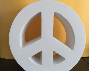 Sculpture carved in plaster of the peace symbol, ready to paint, mold.