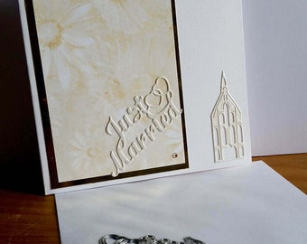A square white wedding card, handmade, handcrafted, embellished.