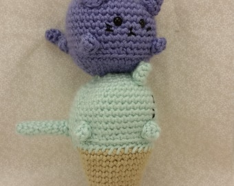 kitty cat ice cream cone with cherry on top